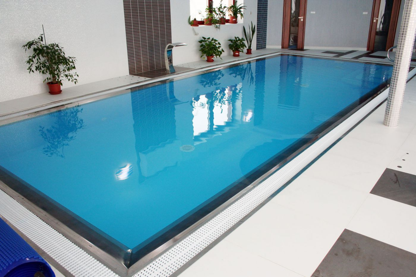 The Overflow Drain Directly Connects To Pool Wall